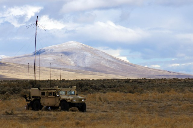 Soldiers operate a retransmission point from a Humvee at the Yakima Training Center, Wash., during the 16th Combat Aviation Brigade's aerial gunnery, Oct. 24, 2012.