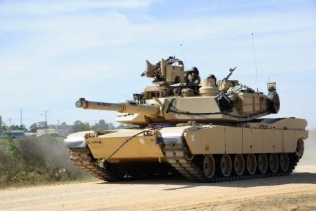 An M1A2 Abrams main battle tank performs tactical maneuvers near Geronimo Landing Zone during Joint Readiness Training Center - Decisive Action, Oct. 15, 2012. The exercise includes emphasis on joint forcible entry, phased deployment with an airborne parachute operation, a combined noncombatant evacuation, combined arms maneuver, wide area security, unconventional warfare and unified land operations in a joint, interagency, intergovernmental and multinational environment.