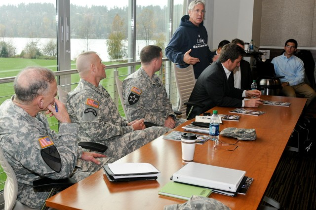 Pete Carroll, the head coach of the Seattle Seahawks, speaks to 7th Infantry Division Soldiers and former NFL players about raising awareness of traumatic brain injury during a conference at Virginia Mason Athletic Center in Seattle, Nov. 20, 2012. The U.S. Army and NFL recently teamed up to help address the issue of traumatic brain injury.