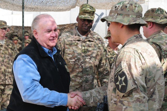 Undersecretary Army Joseph W. Westphal presents a coin to Soldier from the 4th Stryker Brigade Combat Team, 2nd Infantry Division, during a Thanksgiving visit to Combat Outpost Zangabad, Afghanistan, Nov. 22, 2012. Westphal and the Vice Chief of Staff of the Army visited the base and several others to show Soldiers their appreciation.