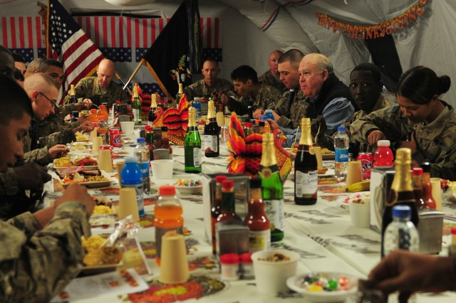 Undersecretary Army Joseph W. Westphal (right-center) listens to Soldiers at Forward Operating Base Pasab, Afghanistan, during Thanksgiving dinner, Nov. 22, 2012. Westphal and the Vice Chief of Staff of the Army visited the base and several others to show Soldiers their appreciation.