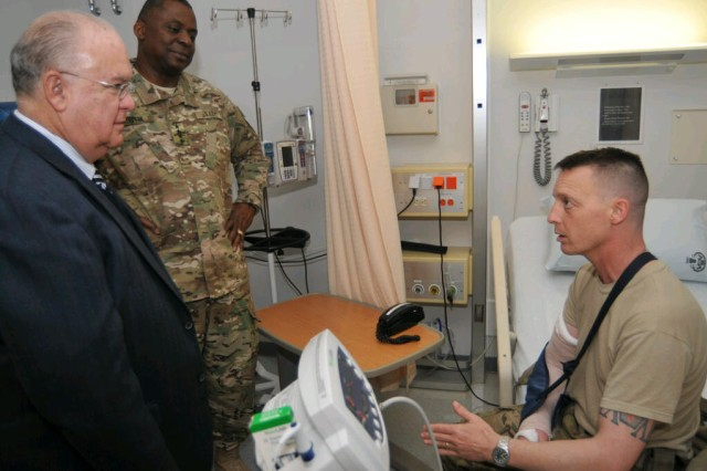 Under Secretary of the Army Joseph W. Westphal and Army Vice Chief of Staff General Lloyd J. Austin III visited wounded warriors, Nov. 23, 2012, at Landstuhl Regional Medical Center, Germany. Westphal and Austin visited LRMC after spending Thanksgiving with Soldiers in Afghanistan. Westphal said morale was high and Soldiers are seeing good results as they prepare for the 2014 withdrawal of NATO forces. Westphal praised the continuum of military medical care from combat zones, to LRMC, to long-term definitive care at stateside hospitals, such as Walter Reed National Military Medical Center in Bethesda, Md.