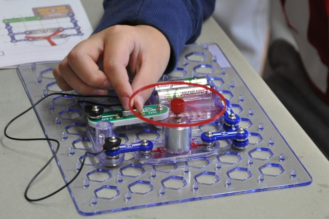 A student at the Ridge and Valley Charter School puts the final touches on an electronic circuit to power a small motor during an hour-long session guided by Ralph Tillinghast, a lab director with the Armament Research, Development and Engineering Center at Picatinny Arsenal. The center has ongoing outreach efforts to promote technical fields.
