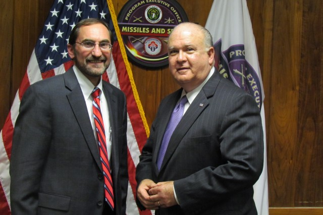 Army undersecretary Joseph Westphal, right, meets Barry Pike, the program executive officer for missiles and space.
