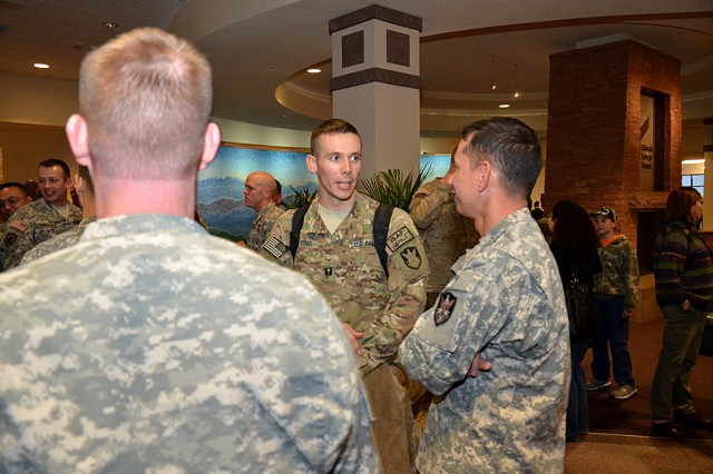 Capt. Kent B. Gneiting from Army Space Support Team 21 talks to fellow Army Space Soldiers during the teams welcome home at the Colorado Springs Airport Nov. 18.