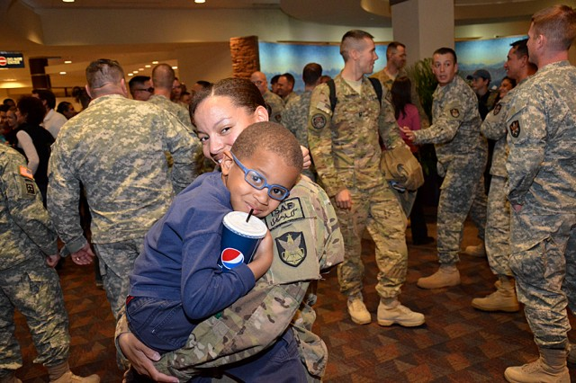 Spc. JoAnnastacia Gage from Army Space Support Team 11 gets a hug during the team's welcome home at the Colorado Springs Airport Nov. 18.