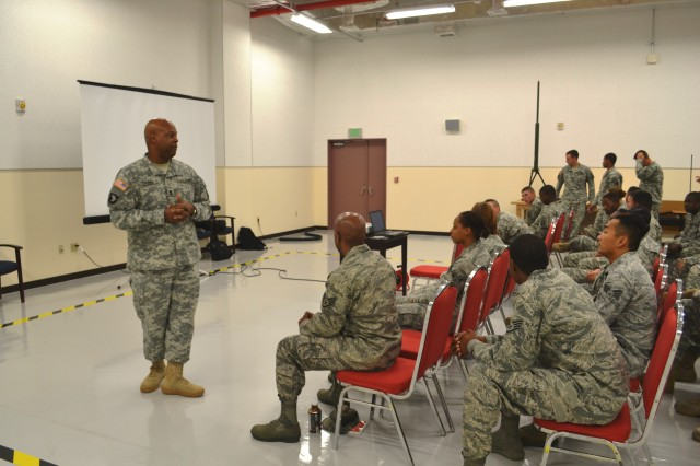 Master Sgt. James A. Young, signal non-commissioned officer in charge, 10th Regional Support Group, welcomes Soldiers and Airmen to the joint communications training at Torii Station's Training Support Center. Soldiers and Airmen attended the training to enhance their skill sets with signal communications equipment to effectively work in a joint environment.