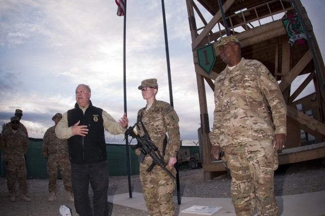 Undersecretary of the Army Joseph W. Westphal preparing to award Pfc. Ashley M. Beltnick, 4th Infantry Brigade Combat Team, 1st Infantry Division, with the Combat Medical Badge, Nov. 21, 2012, at Forward Operating Base Sharana, Afghanistan, for providing medical care under fire. The purpose of of the visit by Westphal and Vice Chief of Staff of the Army Gen. Lloyd J. Austin III was to meet with deployed troops in Afghanistan during the Thanksgiving holiday period to underscore senior Army leader support for the service and sacrifice of Soldiers and civilian employees.