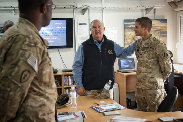 Undersecretary of the Army Joseph W. Westphal greeting Spc. Russell at the Warrior Recovery Center, where the region's injured service members are treated and rehabilitated before they can head back to their units in the field, Nov. 22, 2012, at Kandahar Airfield, Afghanistan.  The purpose of of the visit by Westphal and Vice Chief of Staff of the Army Gen. Lloyd J. Austin III was to meet with deployed troops in Afghanistan during the Thanksgiving holiday period to underscore senior Army leader support for the service and sacrifice of Soldiers and civilian employees.