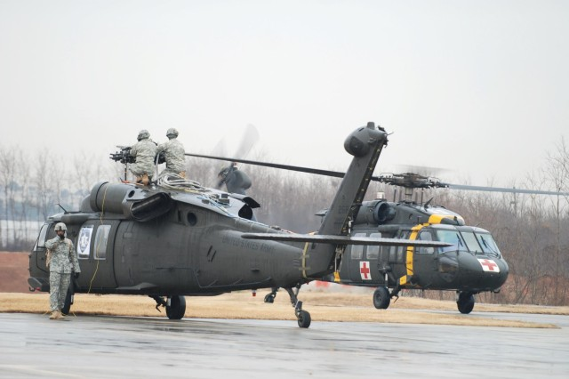 Maintainers from 3rd General Support Aviation Battalion, 2nd Aviation Regiment, 2nd Combat Aviation Brigade, 2nd Infantry Division, repair a Black Hawk helicopter at Camp Humphreys, South Korea.  These Soldiers took runner-up in the Army Award for Maintenance Excellence in the Medium MTOE Category.  Four other 2nd Inf. Div. unit also placed in the AAME.