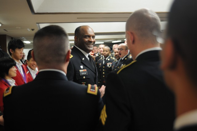 Maj. Gen. Michael T. Harrison, commander of the U.S. Army Japan and I Corps (Forward), congratulate members of the U.S. Army Pacific Band after their fourth performance during the Japan Self Defense Force Marching Band Festival at the famed Nippon Budokan concert hall in Tokyo on November 17.