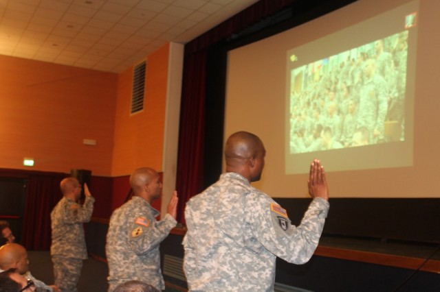 "VICENZA, Italy (Nov. 16, 2012) ""  Soldiers with 509th Signal Battalion reaffirm their oath of office in Vicenza with their fellow 5th Signal Command Soldiers via video teleconference during the 2012 Operation Solemn Promise annual commemoration event. More than 2,000 Soldiers, Civilians, Local Nationals and Family Members gathered in the Lucius D. Clay Kaserne Fitness Center and through video teleconference Nov.16 to participate in 5th Signal Command's Operation Solemn Promise annual commemoration ceremony. This year's commemoration ceremony officially began 5th Signal Command's Army Profession campaign."