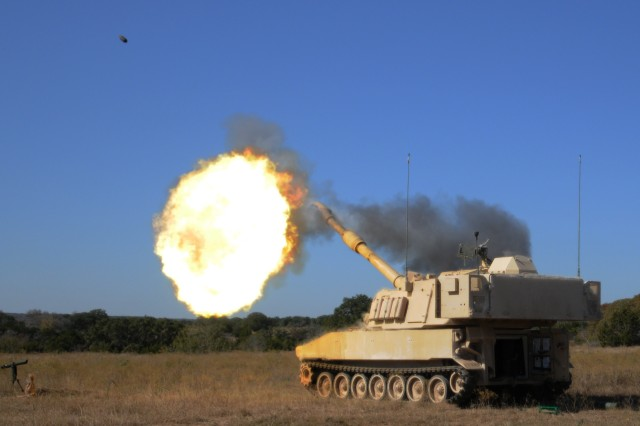 """A 155mm round expends from a M109A6 """"Paladin"""" howitzer during the 3-82 Field Artillery Regiment's, 2nd Brigade Combat Team, 1st Cavalry Division, artillery live-fire exercise at Fort Hood, Texas, Nov. 14, 2012."""