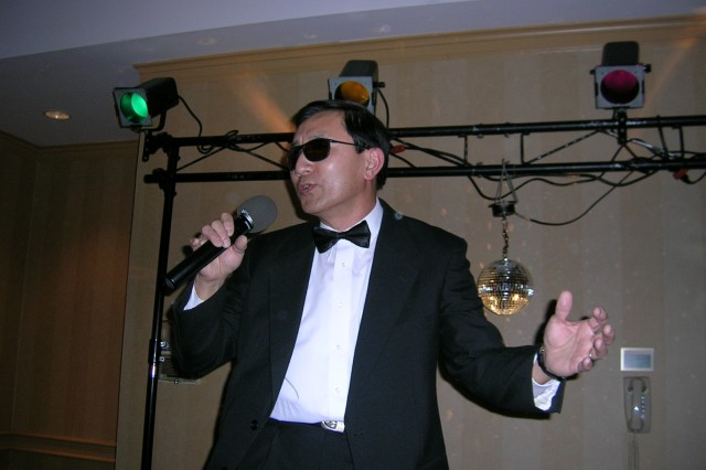 Tom Yang of the Natick Soldier Research, Development and Engineering Center, sings karaoke. He will be featured on NOVA's 'Secret Life of Scientists and Engineers.'
