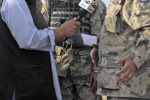 An Afghan news reporter interviews Afghan Brig. Gen. Tasfir Khan commander of the 3rd Zone Afghan Border Police, during Operation Southern Strike IV, Kandahar Province, Afghanistan, Nov. 15, 2012. The operation focused on removing insurgent influence on the local population and connecting isolated villages to their government and police.