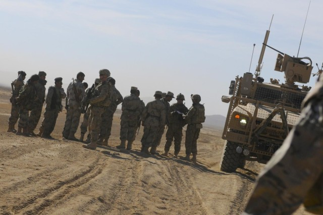 American and Albanian coalition forces meet with members of the Afghan Border Police during a convoy into remote villages as part of Operation Southern Strike IV, Kandahar Province, Afghanistan, Nov. 15, 2012. The operation focused on removing insurgent influence on the local population and connecting isolated villages to their government and police.