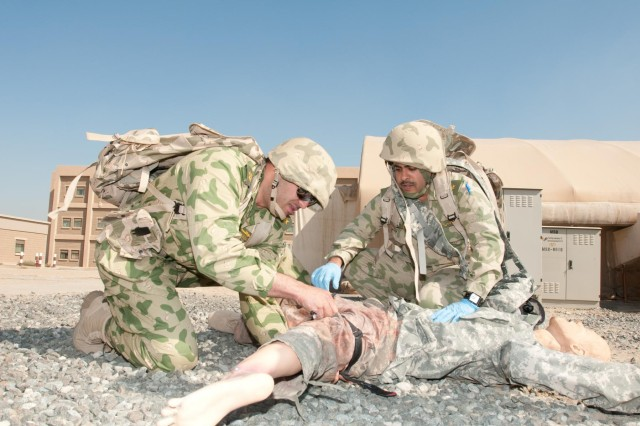 Kuwait National Guard 1st Lt. Hashem Al-Refae and 1st Lt. Hamad Al-Shetail treat a medical dummy during the combat lifesaver practical exercise. The practical exercise is designed to simulate a combat situation where Soldiers gain fire superiority, stop their patients' bleeding and then get them to cover where they can call for help. The Kuwait National Guard Officers attended the combat lifesaver course to participate and share experiences on how the Kuwait National Guard and the U.S. Army conducts medical training to non-medical personnel.