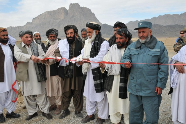 Panjwa'i District leaders and village elders officially open the Salahan-Demrasi-Muhajerin Road in Salahan, Afghanistan, Nov. 25, during a ribbon-cutting ceremony. Local Afghans now have better access to markets and a safer way to travel because of the road. Soldiers of Combined Task Force 4-2 (4th Stryker Brigade Combat Team, 2nd Infantry Division), attended the ceremony and interacted with their new Afghan partners they will be working with throughout the unit's deployment in Support of Operation Enduring Freedom. (U.S. Army photo by Sgt. Kimberly Hackbarth, CTF 4-2 Public Affairs Office)
