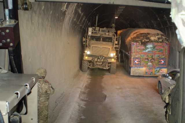Vehicles pass within inches of each other through the darkened Salang Tunnel in Parwan province, Afghanistan, recently. Inside, the tunnel can become pitch black, and the air is filled with deadly carbon monoxide. While there are other routes through the Hindu Kush, the tunnel is the quickest, most efficient road and deemed most protected from insurgent attacks.