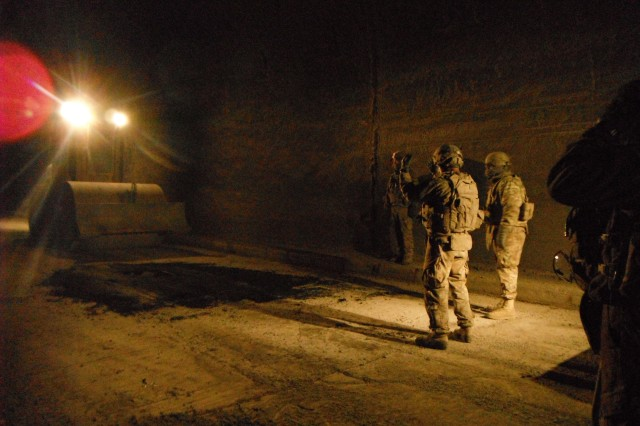 Soldiers work on improving the road surface inside the Salang Tunnel during Operation Mountain Blade in Parwan province, Afghanistan, recently. The operation, conducted by engineering elements of Joint Task Force Empire, improved the road surface of the pass in preparation for winter. The engineers worked primarily at night due to the large amount of vehicles using the roadway every day.