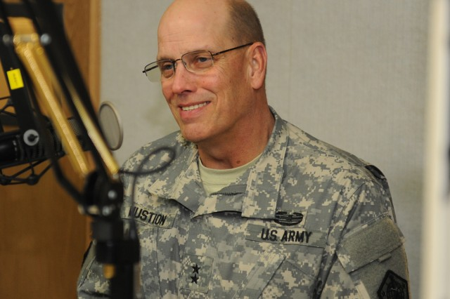 Human Resource Command Commanding General Maj. Gen. Richard P. Mustion discusses Army personnel policies on the Armed Forces Network in Korea, Nov. 28.