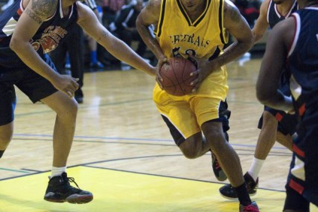 Ernest Hassell, HHC Regiment (The Old Guard), goes for a basket during a game against Fort Meade during the Operation Santa Holiday Toy Drive basketball tournament in the fitness center on JBM-HH Dec. 3, 2011. Each of the players had to bring a toy to enter the tournament.