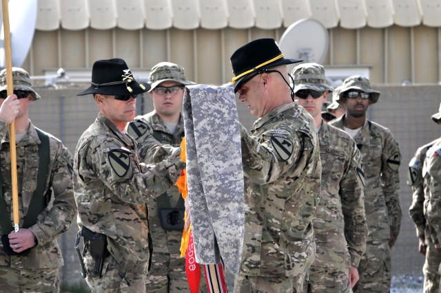 "LAGHMAN PROVINCE, Afghanistan "" Col. Bill Benson, the commander of 4th Brigade Combat Team, 1st Cavalry Division, and Command Sgt. Maj. Christopher Menton, the brigade command sergeant major, uncase the brigade colors during a transfer of responsibility ceremony at Forward Operating Base Gamberi Nov. 25, 2012.  The brigade officially assumed its role as the first security force assistance brigade in Afghanistan during the ceremony.  (U.S. Army photo by Staff Sgt. Jeff VanWey, 4th BCT, 1st Cav. Div. PAO)"