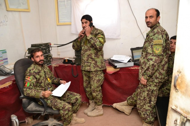 Afghan National Army Soldiers from 4th Brigade and 205th Corps make radio transmissions to the soldiers in the field during Operation Kalak Hode VI in the 205th Corps joint Tactical Operations Center in Tarin Kot Uruzgan, Nov. 11, 2012.