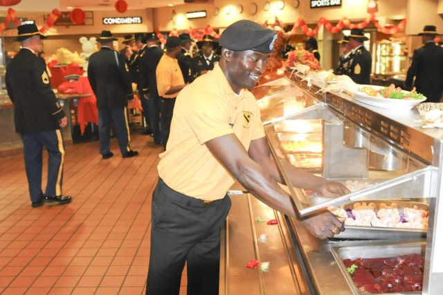 "FORT HOOD, Texas--A Soldier assigned to the Operation Iraqi Freedom Dining Facility, 3rd ""GreyWolf"" Brigade Combat Team, 1st Cavalry Division, helps maintain food trays for lunch on Thanksgiving day November 22, 2012 at Fort Hood, Texas.  The DFAC served a Thanksgiving style lunch to individuals here."