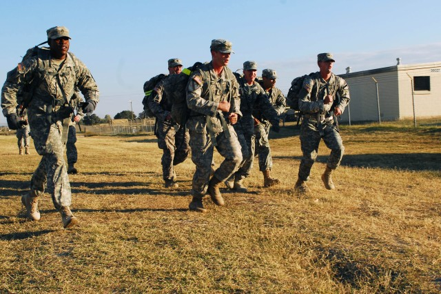 "FORT HOOD, Texas -- Team 10, comprised of seven Soldiers of B Troop ""Black Hawk,"" 1-7 Cav, 1st BCT, 1st Cav. Div., race to the finish line at the end of their 7.1 mile ruck competition during GarryOwen Games 2, here, Nov. 16. Team 10 was the first team to finish with a time of one-hour and 26-minutes. The event honors the Veterans of the Battle of Ia Drang Valley, which occurred in 1965 between American and North Vietnamese forces."
