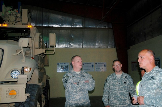Brig. Gen. Duane A. Gamble (left), deputy commanding general, Army Sustainment Command,  and Maj. Gen. Kurt J. Stein (right), commanding general, 1st Theater Sustainment Command, receive a tour of Army Prepositioned Stock-5 warehouse from Col. John D. Kuenzli, commander, 402nd Army Field Support Brigade on Nov. 15 at  Camp Arifjan, Kuwait. (Photo by Johnnie Frazier, 402nd AFSB Public Affairs)