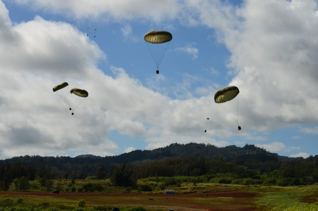 The 84th Eng. Bn., 130th Eng. Bde., 8th TSC, works with the Air Force's 15th Wing to airdrop cargo from a C-17 onto a drop-zone at Kahuku Training Area, Oct. 5.