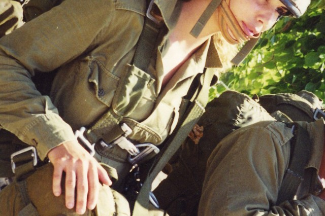 Lietenant Ifat Alkobi (today, Ifat Levine) prepares for airborne training in September 2005. Levine, now a Vicenza Military Community family member, was the first woman to serve as an officer in an Israel Defense Forces infantry battalion. She will be the keynote speaker at the Vicenza community's first Female to Female social networking event for incoming single females. The F2F event will be held at Caserma Ederle in Vicenza, Italy, Dec. 6 to proactively create a nurturing social environment that puts single women, whether Soldiers or civilians, at ease and in touch with other women in the community as they begin and adjust to their overseas tour.