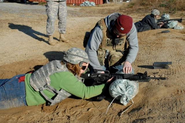 Steve Edgar, Range Safety Officer (right) instructs a member of the 1st Platoon Volunteers on how to zero her M-16 during the Boots on the Ground Day at Fort A.P. Hill, Va.