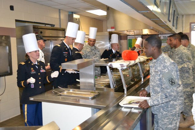 Commanders and senior enlisted leaders serve Thanksgiving dishes to Soldiers on Nov. 20 at the 2nd Brigade Combat Team Dining Facility. Food service staffs across Fort Drum put their skills to the test during the annual  Commanding General's Best Decorated Dining Facility Competition. This year, 3rd Brigade Combat Team took home top honors.