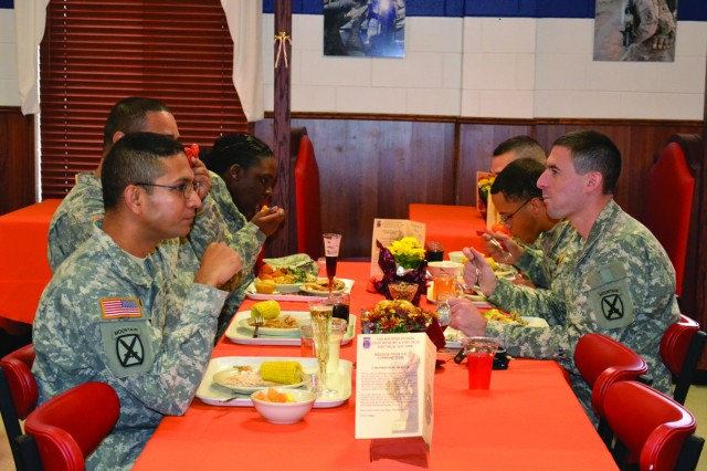 Soldiers of 3rd Brigade Combat Team enjoy their Thanksgiving meals Nov. 20.