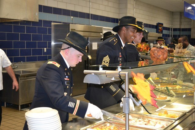 Commanders and senior enlisted leaders serve Thanksgiving dishes to Soldiers on Nov. 20 at the 10th Combat Aviation Brigade Dining Facility. Food service staffs across Fort Drum put their skills to the test during the annual  Commanding General's Best Decorated Dining Facility Competition. This year, 3rd Brigade Combat Team took home top honors.