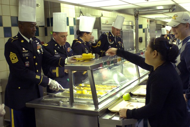 """""""Leaders Brigade"""" officers and noncommissioned officers serve Thanksgiving dinner to Soldiers, retirees, family members and civilians Nov. 22 at Guns and Rockets Dining Facility. The brigade leaders worked in two shifts serving about 1,200 guests."""