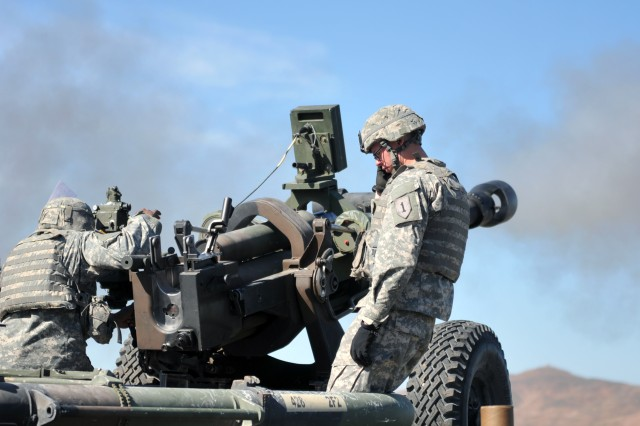 Soldiers assigned to 1st Battalion, 6th Field Artillery, Fort Knox, Ky., fire an M119 howitzer, Oct. 31, at Fort Sill. The unit participated in a combined-arms exercise during the 11-day field training exercise.