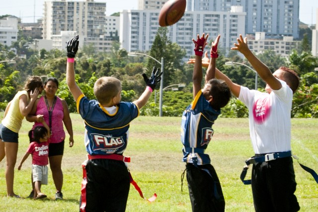 Kobe Brooks (far right), center and son of Army Staff Sgt. Leonidas Brooks, Alpha Company, 2/26th Infantry, 25th Infantry Division, leaps for a pass during a Play Sports Hawaii exhibition game at Ala Puumalu Communty Park, Oct. 21.