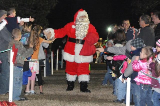 Santa greets children at last year's Christmas Tree Lighting ceremony. This year's ceremony will be Dec. 6 from 5-6 p.m. at Howze Field.