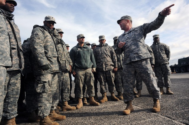 Command Sgt. Maj. Brunk Conley, command sergeant major of the Army National Guard, meets with Soldiers from the New York Army National Guard's 719th Transportation Company who were taking part in Hurricane Sandy relief operations at Floyd Bennett Field in Brooklyn, N.Y., Thursday, Nov. 15, 2012. Conley met with Soldiers in a number of areas affected by Sandy as a way to gain a greater understanding of the needs and challenges of Soldiers on the ground.