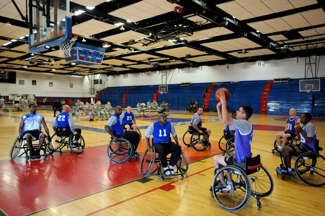 "Two companies within 1st Bn., WTB "" Co. A and Co. B "" compete against each other in a wheelchair basketball tournament game in the Abrams Physical Fitness Center at Fort Hood, Texas, Nov. 21. (U.S. Army photo by Daniel Cernero, III Corps and Fort Hood Public Affairs)"