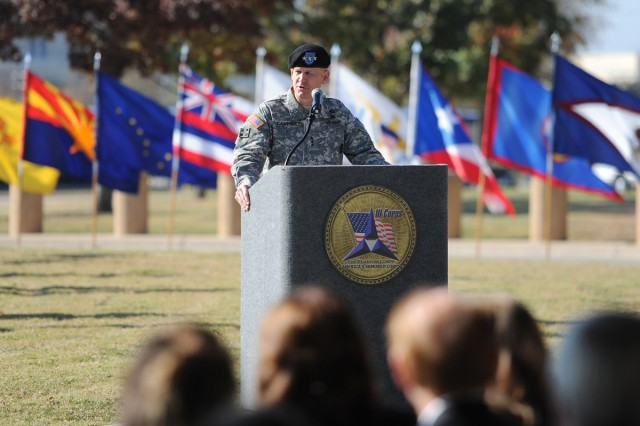 Lt. Gen. Don Campbell Jr., the outgoing III Corps and Fort Hood commanding general, addresses the crowd gathered for the III Corps and Fort Hood Relinquishment of Command Ceremony outside the III Corps Headquarters at Fort Hood, Texas, Nov. 28. Campbell took command of the corps in April of 2011. (U.S. Army photo by Daniel Cernero, III Corps and Fort Hood Public Affairs)