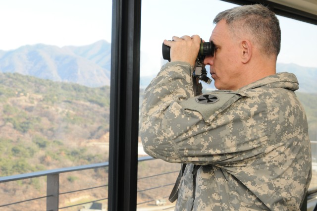 Eighth Army Commander Lt. Gen. John D. Johnson (above) and Command Sgt. Maj. Rodney Harris observed the 2-9th Manchus at Rodriguez Live Fire Complex Nov. 29.