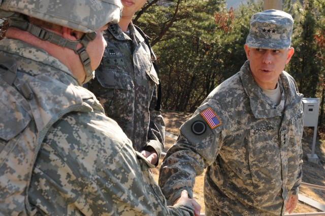 Eighth Army Commander Lt. Gen. John D. Johnson (right) and Command Sgt. Maj. Rodney Harris visited the 2-9th Infantry Manchus at Rodriguez Live Fire Complex Nov. 29.
