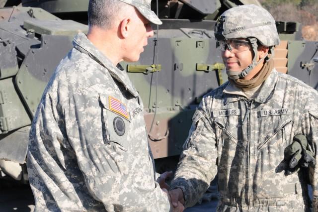 Eighth Army Commander Lt. Gen. John D. Johnson (left) visits the 2-9th Infantry Manchus at Rodriguez Live Fire Complex Nov. 29.
