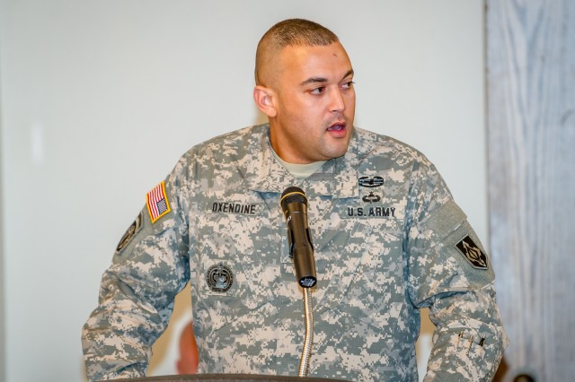 """Sgt. 1st Class Richard Oxendine speaks about his upbringing and experience as a Native American in today's Army during the 2012 Native American Indian Heritage Month observance and luncheon Nov. 29 at the Pershing Community Center. The presentation tied in with this year's theme which is """"Serving Our People, Serving Our Nations: Native Visions for Future Generations."""""""