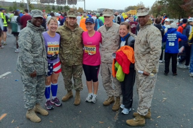 Army Community Service employees Julia Sibilla, second from left, and Norie McCall, second from right, joined Sibilla's daughter, Sasha, center, in Washington, D.C., for the Marine Corps Marathon Oct. 28. Judge Advocate General employee Paola Preto Martini also ran in the race.