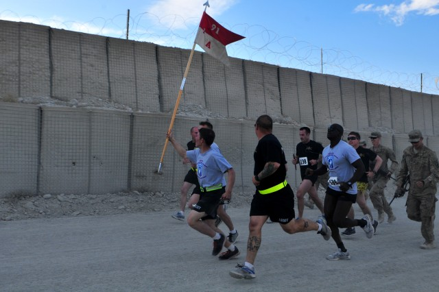 Soldiers from Anvil Troop, 1st Squadron, 91st Cavalry Regiment, 173rd Airborne Brigade Combat Team, run in Afghanistan during the sixth annual Running of the Herd. This year's race was completed in four different countries.